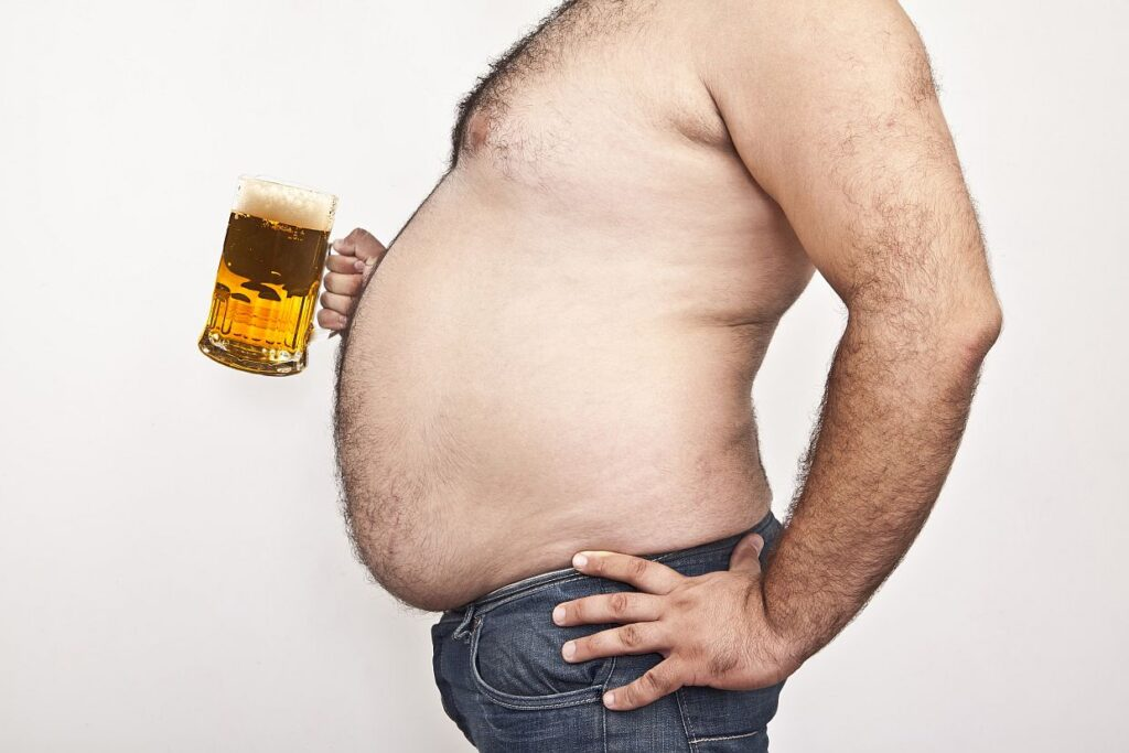Man with big belly holding a mug of beer